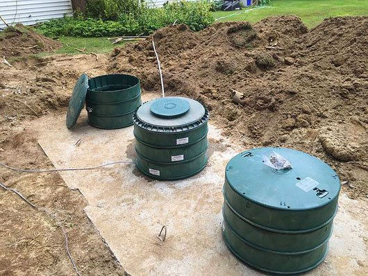 Photo of small waterfront septic system.