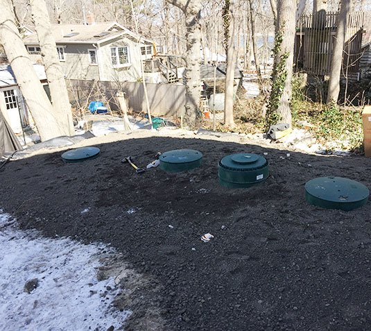 Photo of small lot septic system installation.