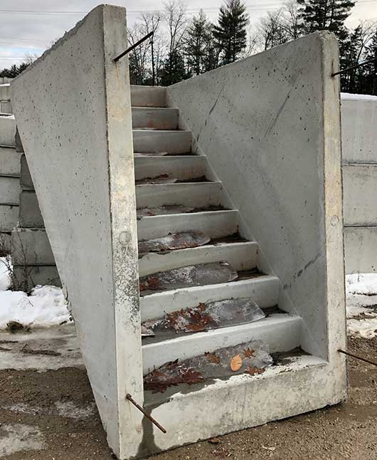 Photo of precast concrete bulkhead steps.