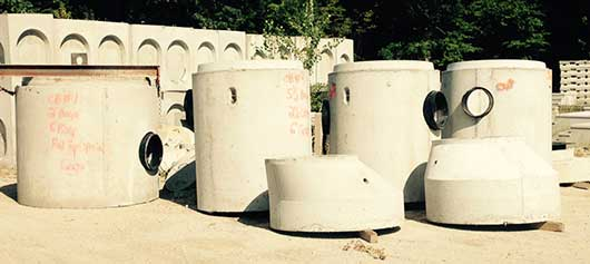 Photo of precast concrete catch basins inventory.
