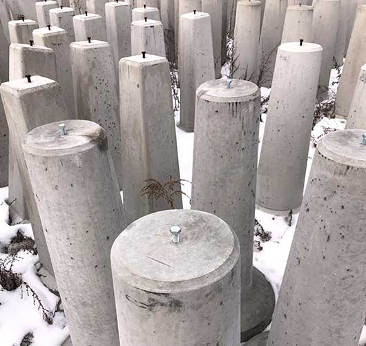 Photo of precast concrete frost posts inventory.