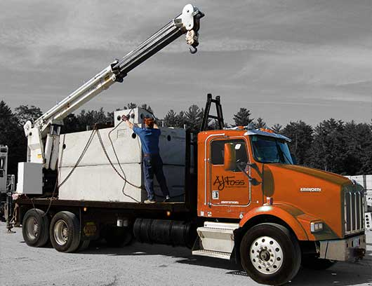 Photo of precast concrete supplier loading truck.