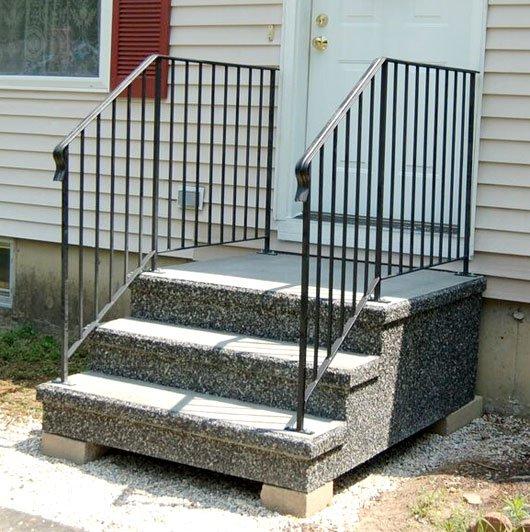 Photo of precast concrete steps with railings.