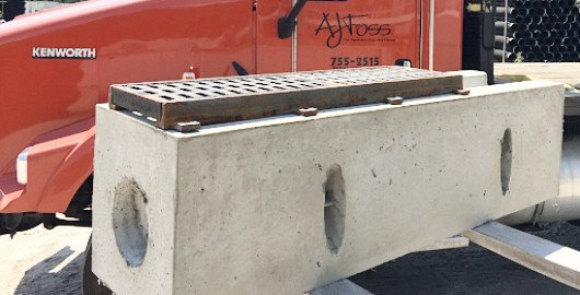Side view of a precast concrete trench drain.